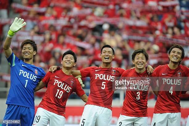 Shusaku Nishikawa,Yuki Muto,Tomoaki Makino,Tomoya Ugajin and Daisuke Nasu of Urawa Red Diamonds celebrate the win after the J.League match between...