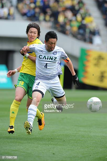 Shusuke Tsubouchi of Thesupa Kusatsu Gunma and Makito Yoshida of JEF United Chiba compete for the ball during the JLeague second division match...
