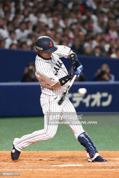 Shuta Tonosaki of Japan bats during the game one of the baseball international match between Japan And Australia at the Nagoya Dome on March 3 2018...