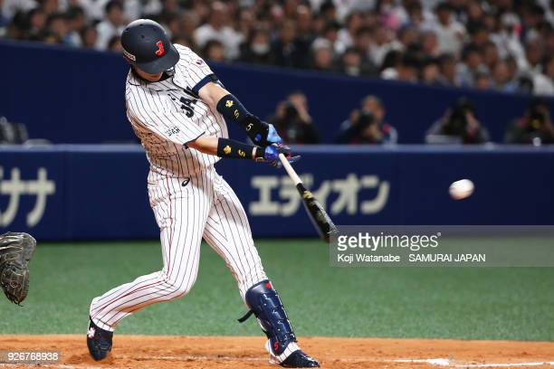 Shuta Tonosaki of Japan hits a single in the bottom half of the second inning during the game one of the baseball international match between Japan...
