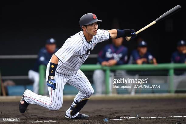 Shuta Tonosaki of Samurai Japan hits a RBI triple during a practice game between Japan and Saitama Seibu Lions at Sokken Stadium on November 13 2017...