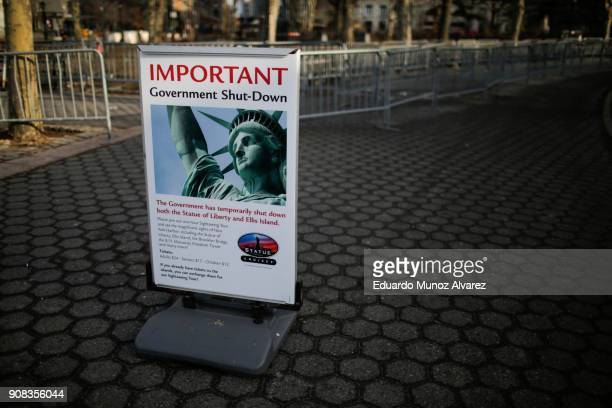 Shutdown placard is seen at the entrance of the Liberty State ferry terminal in Battery Park on January 21 2018 in New York City The iconic landmark...