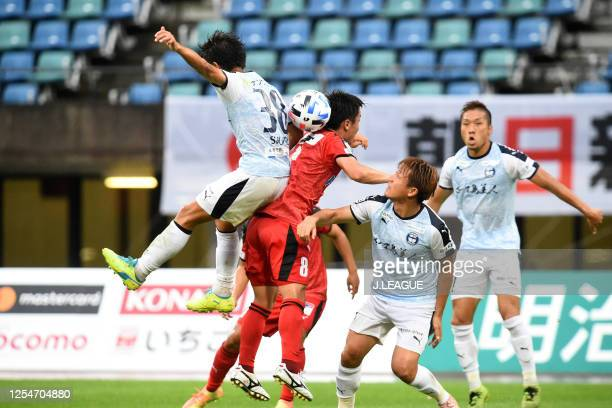 Shuto Nakahara of Kagoshima United and Shuhei Kamimura of Roasso Kumamoto compete for the ball during the JLeague Meiji Yasuda J3 match between...