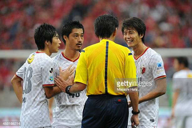 Shuto Yamamoto Mitsuo Ogasawara Shoma Doi of Kashima Antlers exception to refereeYuichi Nishimura during the J League match between Urawa Red...