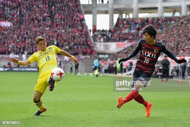 Shuto Yamamoto of Kashima Antlers and Ryuta Koike of Kashiwa Reysol compete for the ball during the JLeague J1 match between Kashima Antlers and...