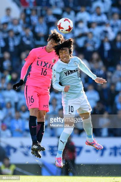 Shuto Yamamoto of Kashima Antlers and Shunsuke Nakamura of Jubilo Iwata compete for the ball during the JLeague J1 match between Jubilo Iwata and...