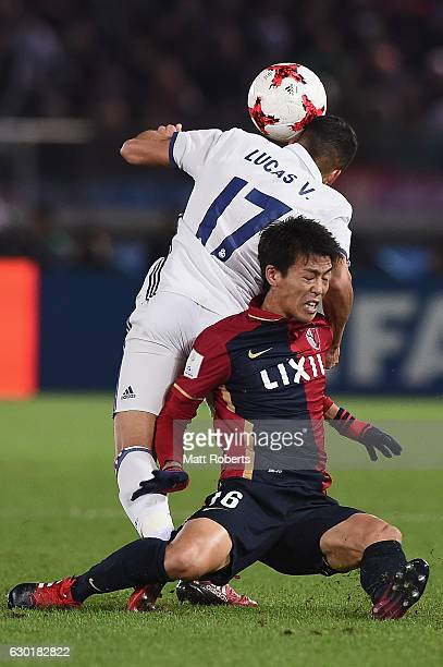 Shuto Yamamoto of Kashima Antlers competes for the ball against Lucas Vazquez of Real Madrid during the FIFA Club World Cup final match between Real...