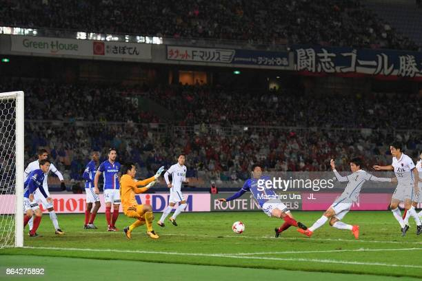 Shuto Yamamoto of Kashima Antlers scores his side's first goal during the J.League J1 match between Yokohama F.Marinos and Kashima Antlers at Nissan...