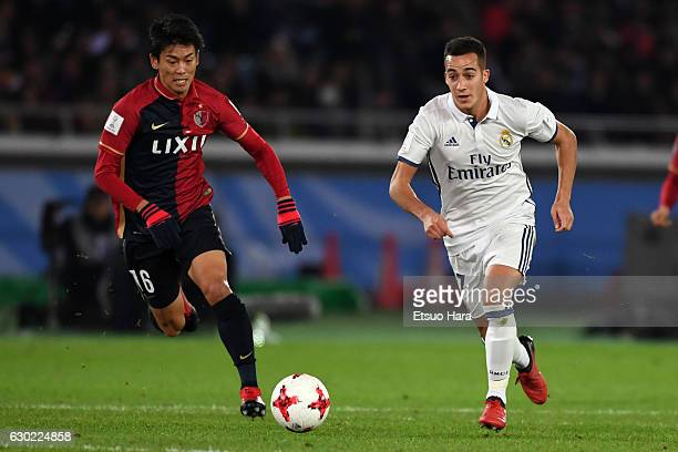 Shuto Yamamoto#16 of Kashima Antlers and Lucas Vazquez of Real Madrid compete for the ball during the FIFA Club World Cup final match between Real...