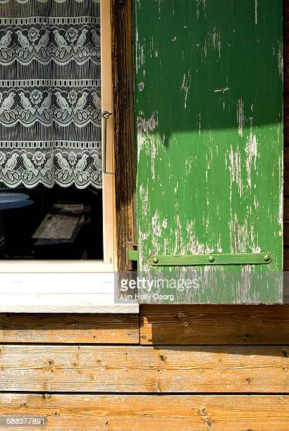 shutter and window with lace curtain - lyn holly coorg stock pictures, royalty-free photos & images