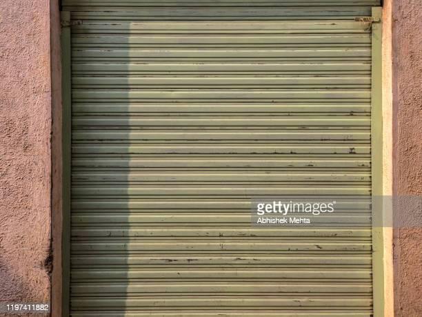 shutter close - 建具 シャッター ストックフォトと画像