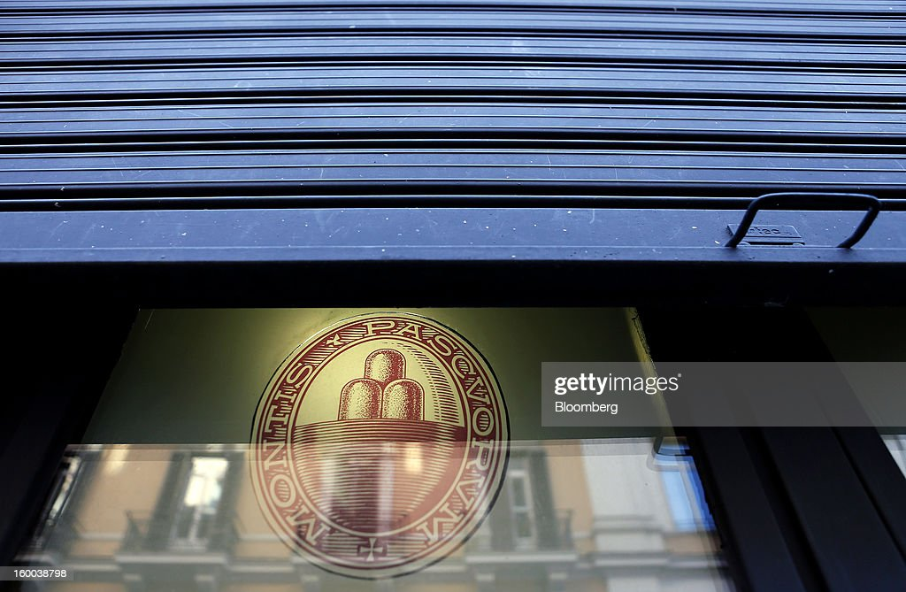 A shutter rests above a logo in the window of a Banca Monte dei Paschi di Siena SpA bank branch in Rome, Italy, on Friday, Jan. 25, 2013. Italian Prime Minister Mario Monti said the Bank of Italy will take another look at Banca Monte dei Paschi di Siena SpA's books after the company disclosed this week it may face more than 700 million euros of losses related to structured finance transactions hidden from regulators. Photographer: Alessia Pierdomenico/Bloomberg via Getty Images