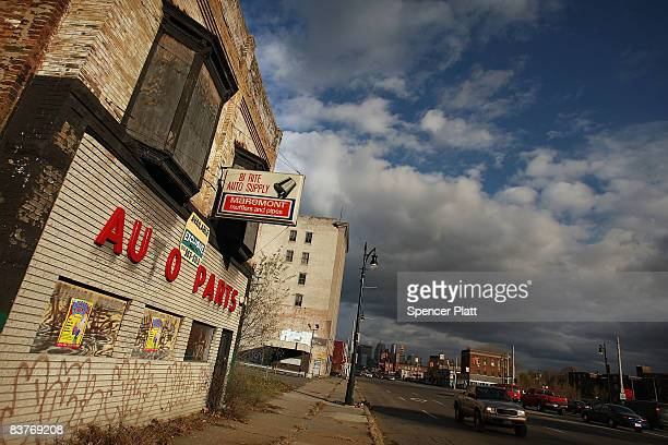 Shuttered businesses line a downtown street November 20 2008 in Detroit Michigan An estimated one in three Detroiters lives in poverty making the...