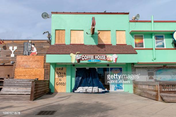 A shuttered coffee house is seen on the Myrtle Beach Board Walk in Myrtle Beach South Carolina on September 12 2018 Hurricane Florence was downgraded...
