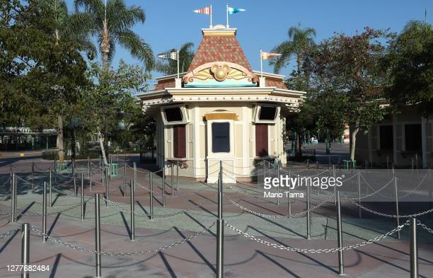 Shuttered ticket windows stand outside the Disneyland theme park on September 30, 2020 in Anaheim, California. Disney is laying off 28,000 workers...