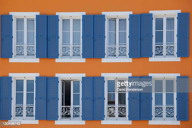 Shutters and windows on ornate building