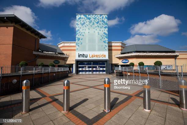 Shutters cover an entrance to the Lakeside shopping centre, operated by Intu Properties Plc, in Thurrock, U.K., on Wednesday, May 6, 2020. Shopping...