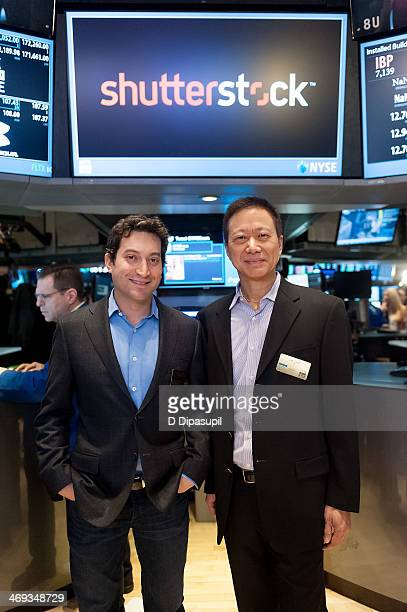 Shutterstock chief executive officer Jon Oringer and Shutterstock chief technology officer James Chou ring the opening bell at the New York Stock...