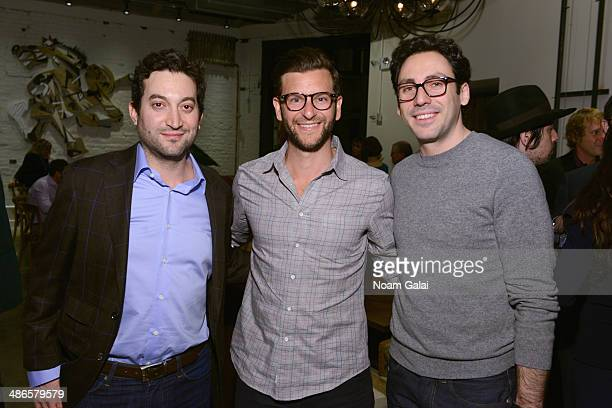Shutterstock chief executive officer Jon Oringer cofounders coCEOs of Warby Parker Dave Gilboa and Neil Blumenthal attend the Disruptive Innovation...