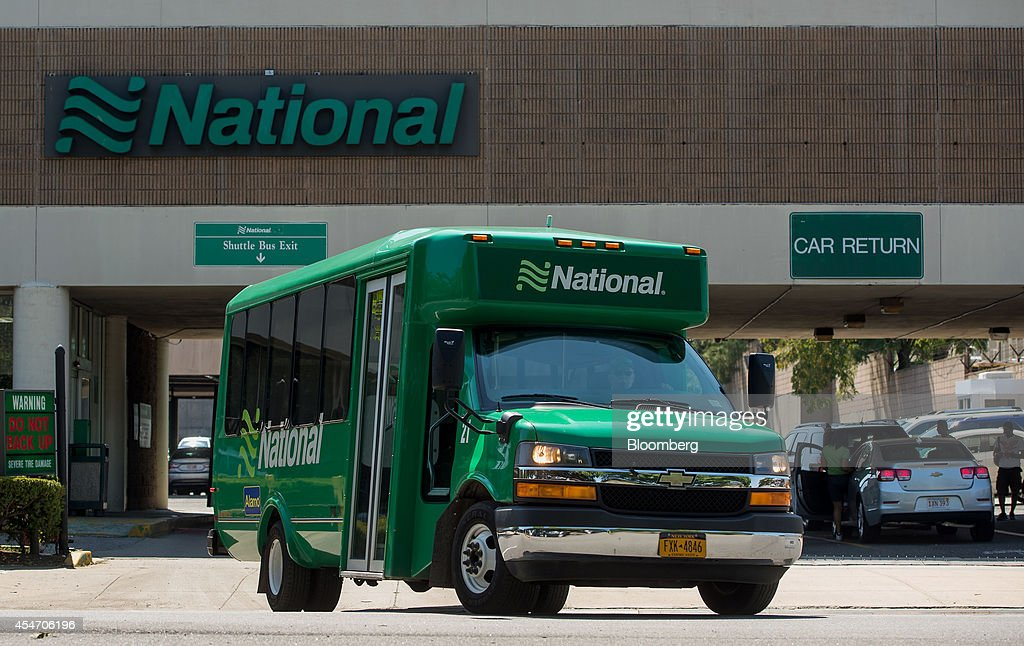 A Shuttle Bus Exits The National Car Rental System Inc