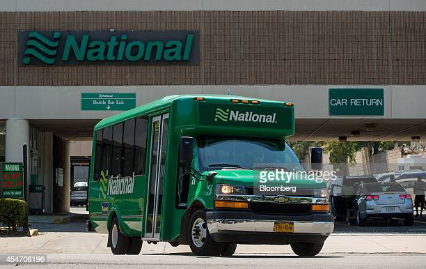 A shuttle bus exits the National Car Rental System Inc location for LaGuardia Airport in the Queens borough of New York US on Monday Aug 25 2014...