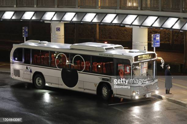 A shuttle bus for Tokyo Disney Resort operated by Oriental Land Co stands parked outside a train station at night in Urayasu Chiba Prefecture Japan...