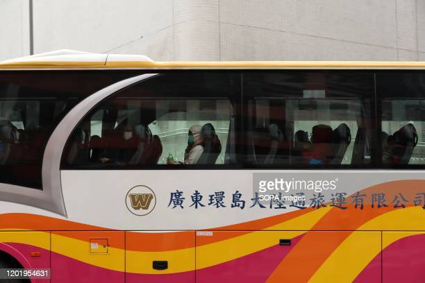 Shuttle bus taking Passengers from Diamond Princess cruise ship to Chung Yeung Estate as soon as they arrived to Hong Kong for another quarantines...