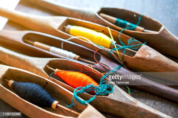 Shuttle Weaving Tool equipment to work natural textile fiber art of the household industry. Can be seen in the countryside of Thailand.