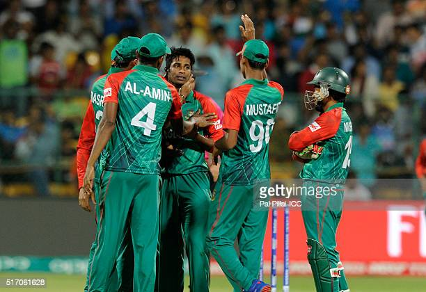 Shuvagata Hom of Bangladesh celebrates the wicket of Virat Kohli of India during the ICC World Twenty20 India 2016 match between India and Bangladesh...