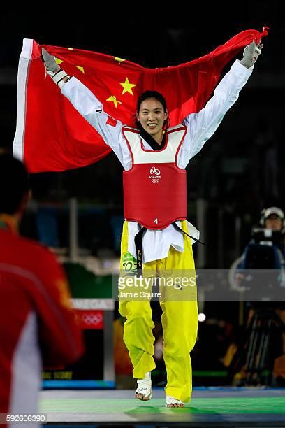 Shuyin Zheng of China celebrates beating Maria del Rosario Espinoza Espinoza of Mexico during the Taekwondo Women 67kg Gold Medal Contest on Day 15...