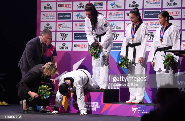 Shuyin Zheng of China collapses during the medal ceremony after defeat by Bianca Walkden of Great Britain in the Final of the Women's 73kg during Day...