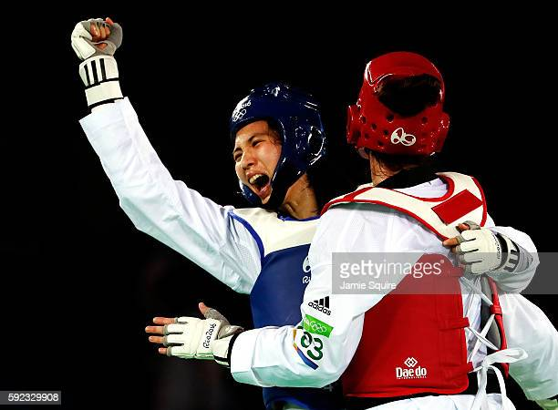 Shuyin Zheng of China reacts after winning a point during the Women's 67kg Taekwondo Semifinal match against Bianca Walkden of Great Britain at the...