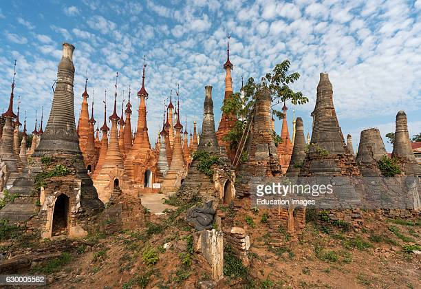 Shwe Inn Thein Paya crumbling Buddhist stupas in Inthein Indein near Inle Lake in Shan State Burma Myanmar