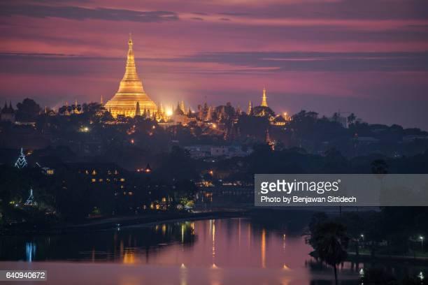 Shwedagon Pagoda and Kandawgyi Lake at dusk, Yangon, Myanmar
