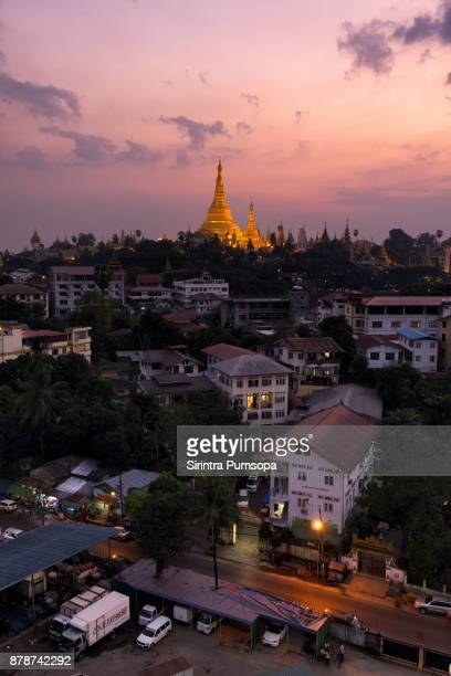 shwedagon pagoda at sunset, yangon, myanmar - yangon stock pictures, royalty-free photos & images