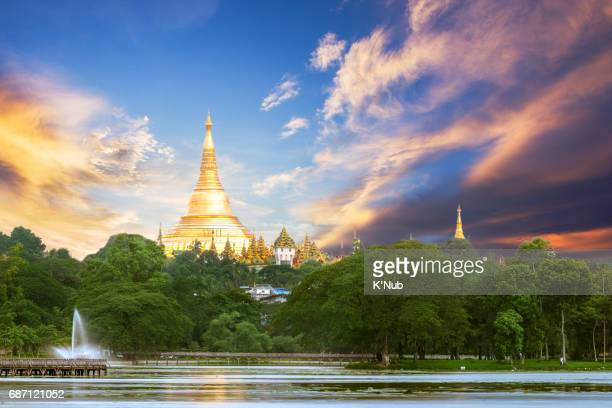 shwedagon pagoda in sunset time - yangon stock pictures, royalty-free photos & images