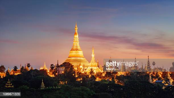 shwedagon pagoda sunset yangon myanmar panorama - yangon stock pictures, royalty-free photos & images