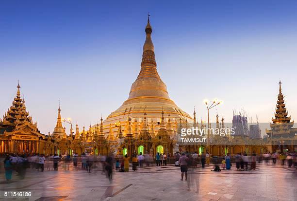 Shwedagon Paya pagoda illuminated in the evening.