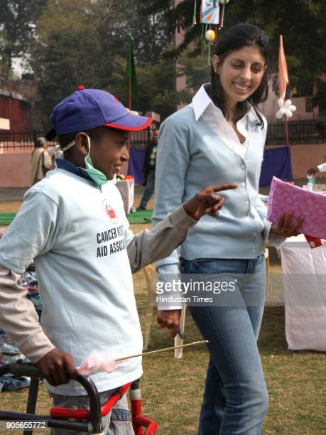 Shweta Nanda daughter of Amitabh Bachchan shairing a Light Moment with a cancer patient during ' Fun Day '' for cancer patients at National Bal...