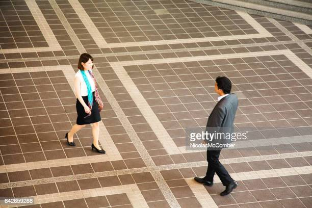 shy japanese businesswoman approaching colleague - approaching stock pictures, royalty-free photos & images