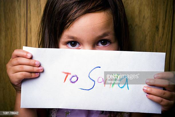 Shy Little Girl Holding a Letter to Santa