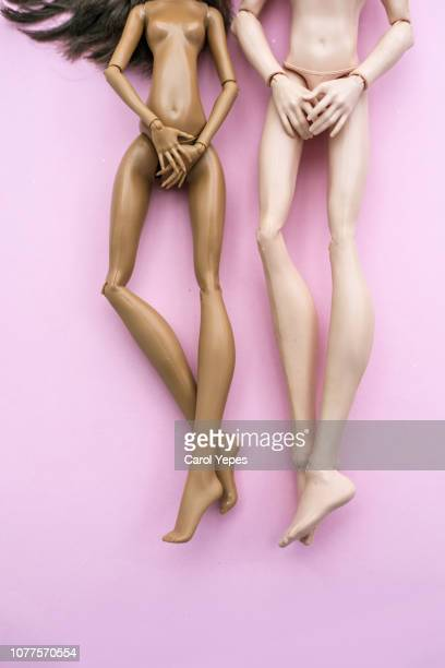 shy naked copule doll in pink - male likeness stock pictures, royalty-free photos & images