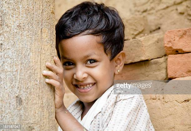 shy smiling sri lankan girl against brick background. - sri lankan school girls stock photos and pictures