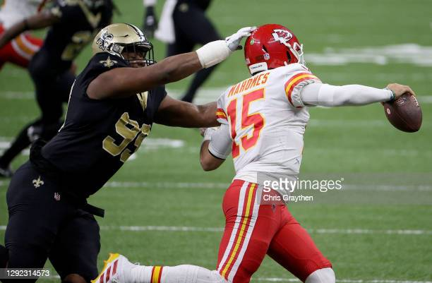 Shy Tuttle of the New Orleans Saints pressures Patrick Mahomes of the Kansas City Chiefs during the third quarter in the game at Mercedes-Benz...