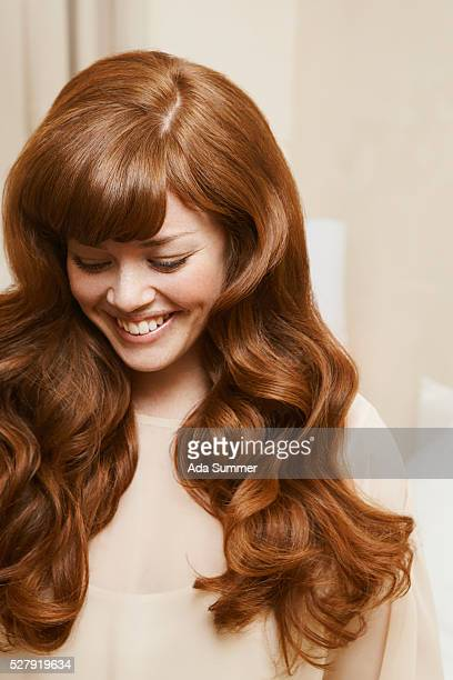 shy woman with wavy hair