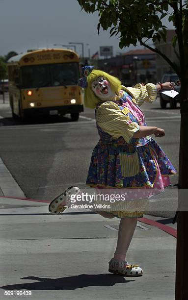 Shylo the clown aka Linda 'PJ' Hulet of Anaheim is caught on the corner of Clementine street and Broadway retrieving her mail from the post office...
