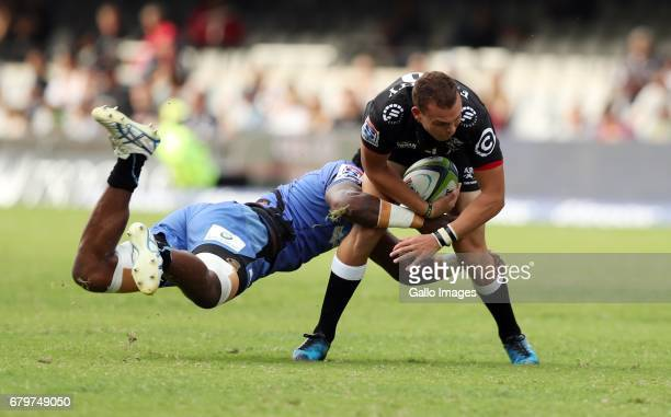si Naisarani of Western Force tackling Curwin Bosch of the Cell C Sharks during the Super Rugby match between Cell C Sharks and Force at Growthpoint...