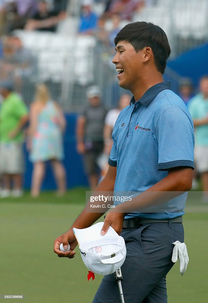 Si Woo Kim celebrates after winning the Wyndham Championship during the final round at Sedgefield Country Club on August 21, 2016 in Greensboro, North Carolina.