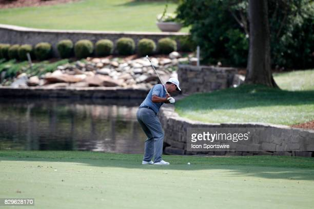 Si Woo Kim hits an iron shot on the 7th hole during the first round of the PGA Championship on August 10 2017 at Quail Hollow Club in Charlotte NC