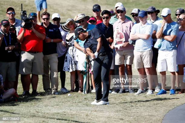 Si Woo Kim of Korea plays a shot on the 14th hole during the third round of THE PLAYERS Championship at the Stadium course at TPC Sawgrass on May 13,...